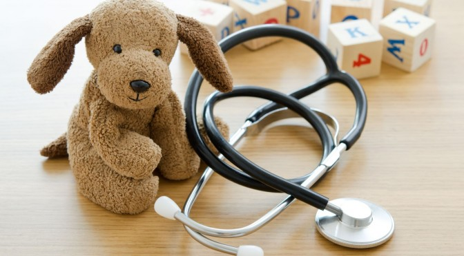 21816466 - pediatrics  puppy toy with medical equipment